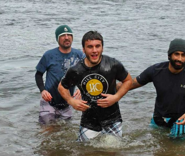 YWAM Richmonders perform baptism in James River.